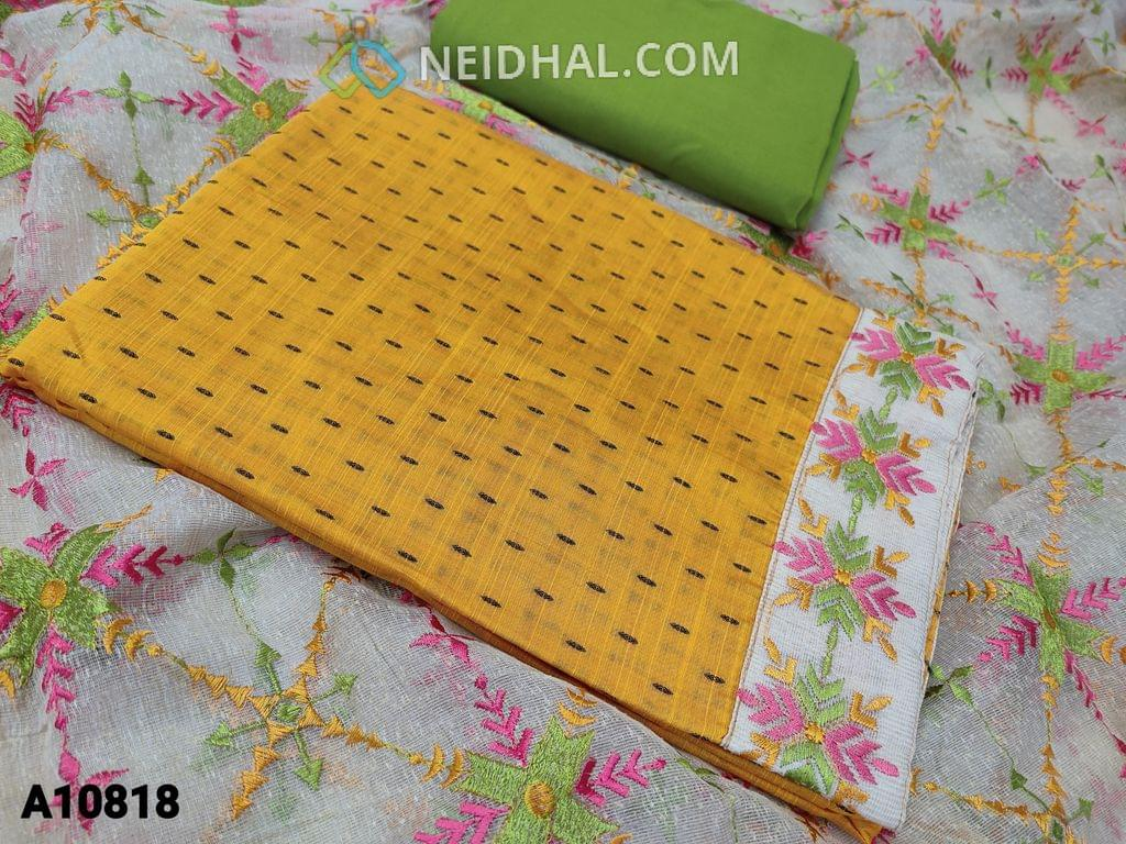 CODE A10818 : Yellow Silk Cotton unstitched salwar material(requires lining) with butta work on either side, embroidery work on daman, green cotton bottom, embroidery work on kora dupatta with tapings