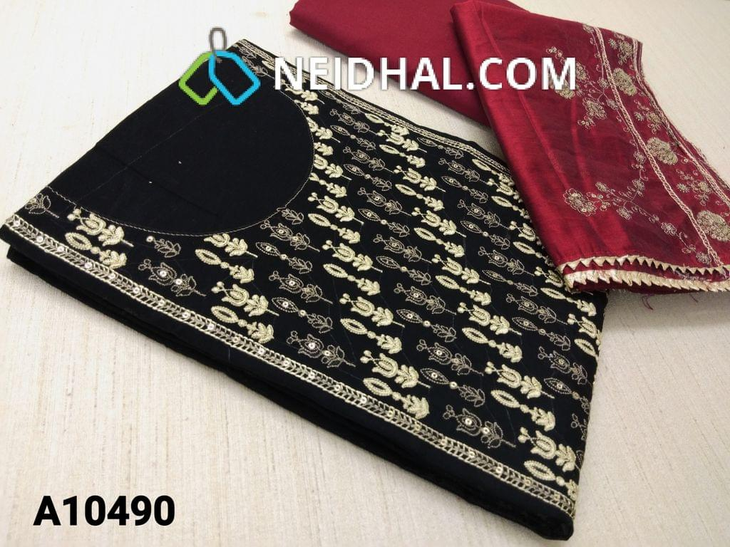 CODE A10490 :  Black Silk Cotton unstitched salwar material(requires lining) with heavy embroidery work on yoke, red cotton bottom, embroidery and sequence work on silk cotton dupatta with tapings.