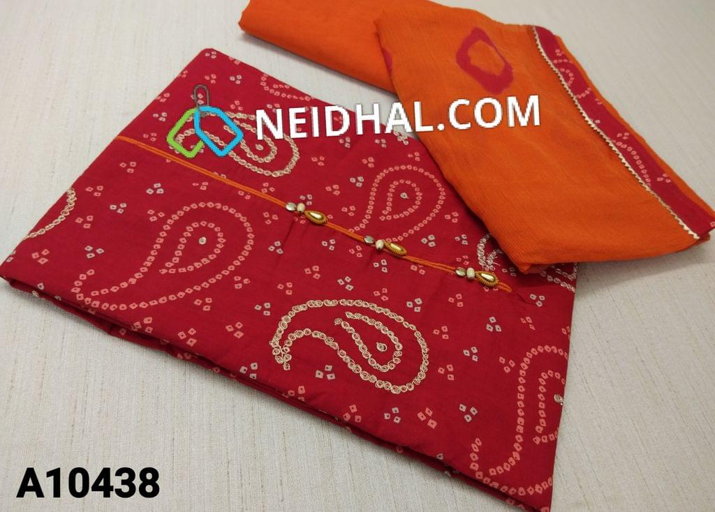 CODE A10438 :  Bhandhi Printed Red Cotton unstitched salwar material(requires lining) with fancy buttons on yoke, zari thread work on front side, orange cotton bottom, printed orange chiffon dupatta with tapings.