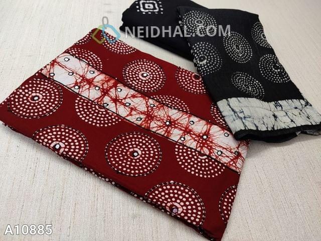 CODE A10885 : Printed Maroon Satin Cotton Unstitched salwar material(requires lining) with thread and foil mirror work on front side, plain back side, batik printed black cotton bottom,  batik printed silk cotton dupatta with tassels(requires taping)