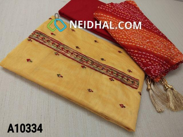 CODE A10334 : Yellow Silk Cotton Unstitched Salwar material(requires lining) with sequence and colourful thread work on front side, plain back side, daman patch, red cotton bottom, bhandhini printed crushed short width silk cotton dupatta with fancy  tapings