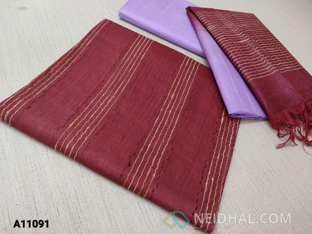 CODE  A11091 : Maroon Silk Cotton Unstitched salwar material(requires lining) with thread weaving on either side, purple silk cotton bottom, thread weaving on dual color silk cotton dupatta with tassels.