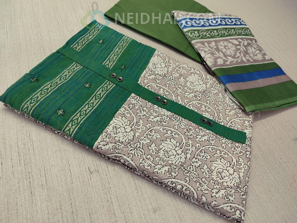 Beige Kalamkari printed Cotton unstitched Salwar material(requries lining) with green patch work on topline, fancy buttons, green Cotton bottom, printed cotton dupatta with tapings
