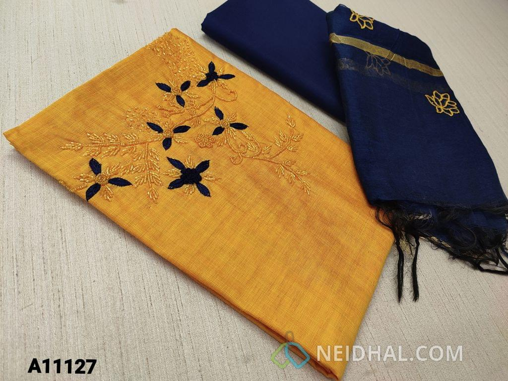 CODE A11127 : Yellow Silk Cotton unstitched Salwar material(requires lining) with pipe bead and thread work on yoke,  blue cotton bottom, embroidery work on silk cotton dupatta  with tassels