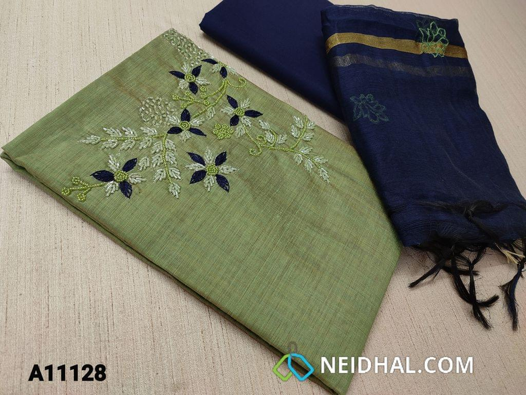 CODE A11128 : Green Silk Cotton unstitched Salwar material(requires lining) with pipe bead and thread work on yoke,  blue cotton bottom, embroidery work on silk cotton dupatta  with tassels