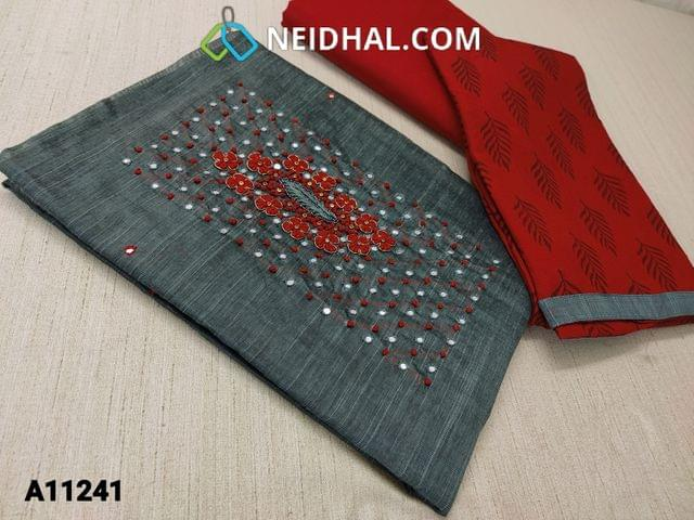 CODE A11241 : Dark Grey Silk Cotton unstitched salwar material(requires lining) with french knot, mini stone and  thread work on yoke, foil mirror work on front side, red cotton bottom, printed chiffon dupatta with tapings.