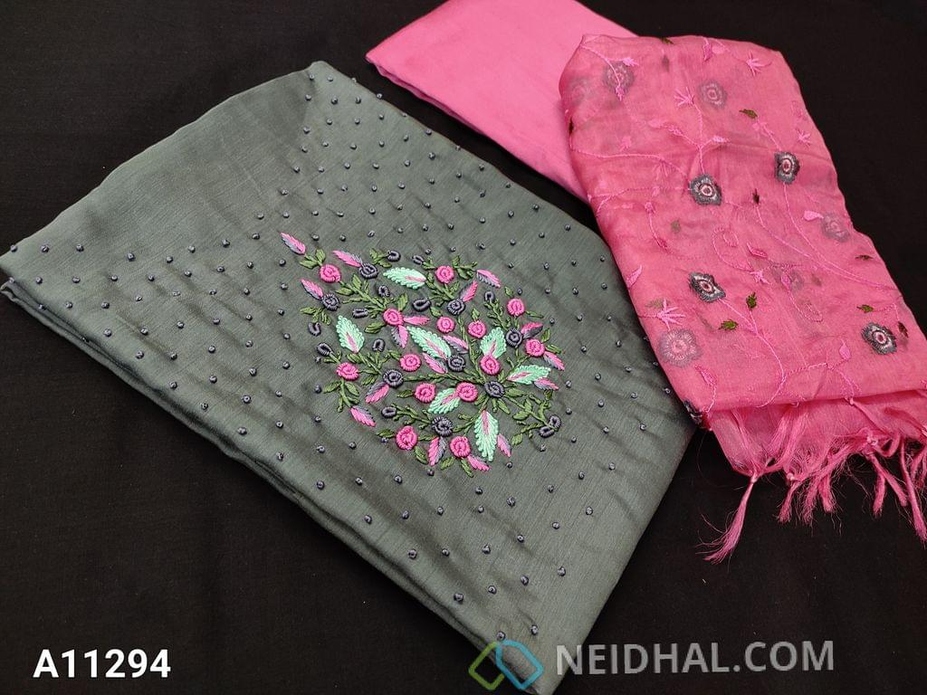 CODE A11294 :Designer Grey Silk Cotton Unstitched salwar material(requires lining) with colorful embroidery and french knot work on yoke, pink silk cotton bottom, embroidery work on organza dupatta with tassels.