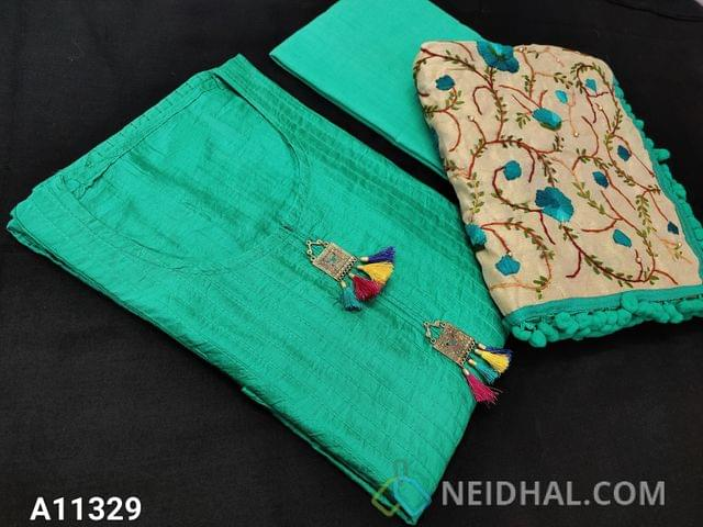 CODE A11329 : Designer Turquoise Green Silk Cotton unstitched Salwar material(requires lining) with pintuk work on front side, stitched round neck, Metal tassels on yoke, Turquoise Green Cotton bottom, Heavy Kantha stitch and stem stich work on Golden Beige silk cotton dupatta with pom pom tapings.