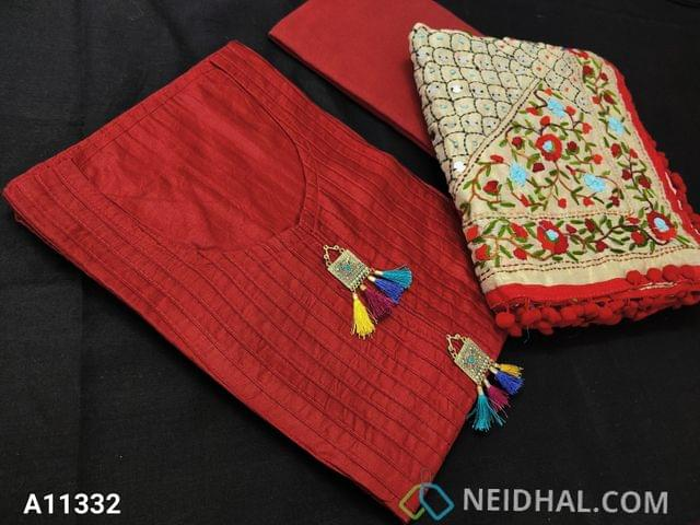 CODE A11332 : Designer Red Silk Cotton unstitched Salwar material(requires lining) with pintuk work on front side, stitched round neck, Metal tassels on yoke, Red Cotton bottom, Heavy Kantha stitch and stem stich work on Golden Beige silk cotton dupatta with pom pom tapings.