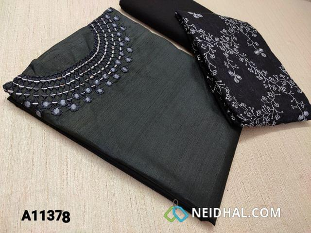 CODE A11378 : Designer Black Glazed Silk Cotton unstitched salwar material(requires lining) with real mirror and thread work on yoke, black cotton bottom, embroidery work on silk cotton dupatta with tassels