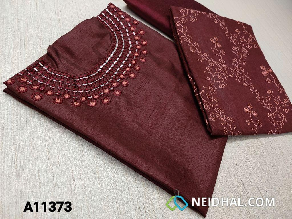 CODE A11373 : Designer Brownish Maroon Glazed Silk Cotton unstitched salwar material(requires lining) with real mirror and thread work on yoke, silk cotton bottom, embroidery work on silk cotton dupatta with tassels