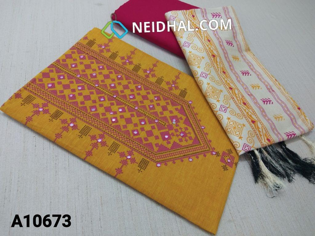 CODE A10673 : Yellow Cotton unstitched salwar material(requires lining) with printed on yoke, foil mirror work on front side, plain back side, pink cotton bottom, printed semi pushmina dupatta(requires taping)