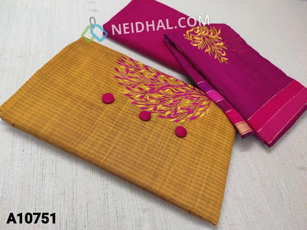 CODE A10751 : Yellow Silk Cotton unstitched salwar material(requires lining) with bttons and embroidery work on yoke, pink cotton bottom, embroidery work on silk cotton dupatta with tassels.
