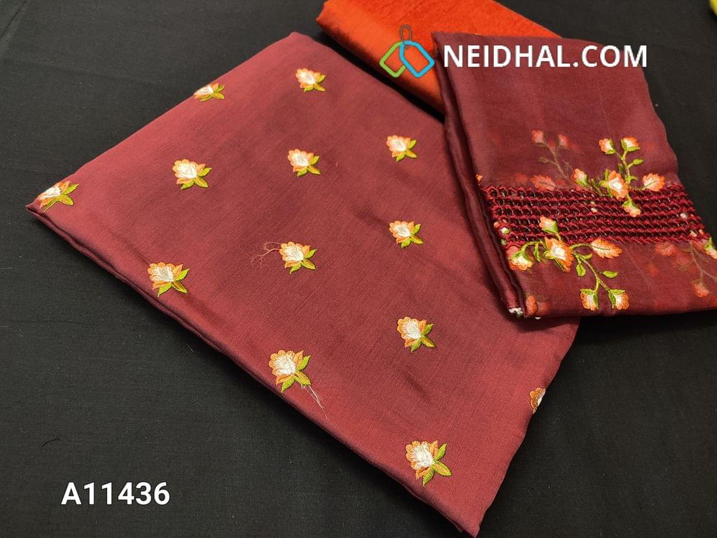 CODE  A11436 : Designer Maroon Silk Cotton Unstitched Salwar material(requires lining) with embroidery work on front side, plain back side, lace work at daman patch, orange silk cotton bottom, embroidery and cut work on organza dupatta with tapings