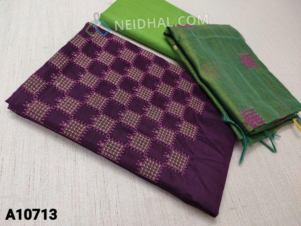 CODE A10713 : Purple Silk Cotton unstitched salwar material(requires lining) with thread work on yoke, green cotton bottom, thred work on silk cotton dupatta with tassels