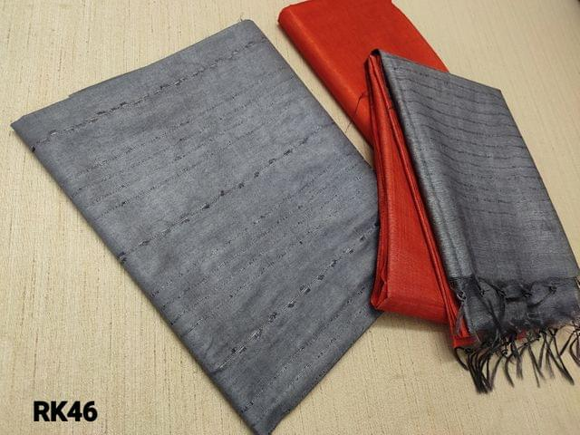 CODE  Rk46 : Grey Semi Jute Silk Unstitched salwar material(requires lining) with Self weaving on either side, Brick Red semi jute silk bottom, Self weaving on dual color semi jute silk dupatta with tassels.