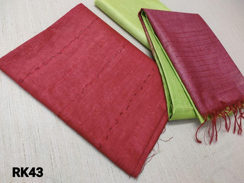 CODE  RK43 : Maroon Semi Jute Silk Unstitched salwar material(requires lining) with Self weaving on either side, Green semi jute silk bottom, Self weaving on dual color semi jute silk dupatta with tassels.