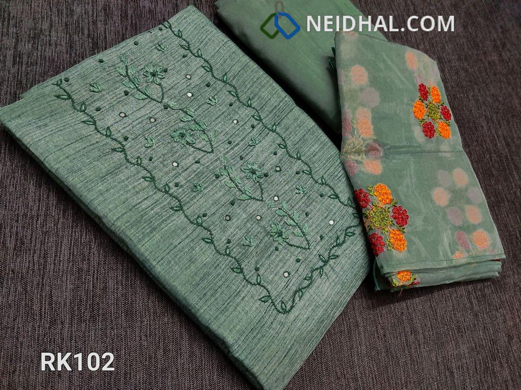 CODE R102 :  Green Semi Jute Silk Cotton unstitched Salwar material (Coarse fabric requires lining), with french knot work, faux mirror and embroidery work on yoke, drum dyed fabric can be used as bottom or lining, Short width Organza dupatta with embroidery work and cut work taping