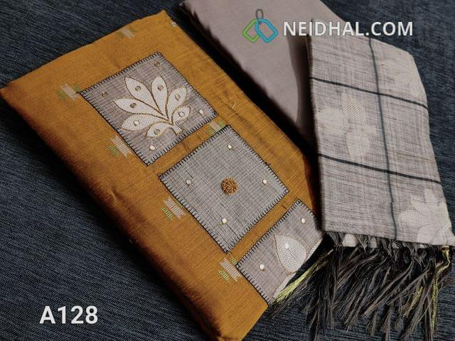 CODE  A128 : Golden Yellow Silk Cotton unstitched Salwar material, Thread and faux mirror work on Yoke patch, Weaving patterns and faux mirror work on front side, Daman patch, Greyish Beige Cotton bottom, Benarasi woven silk cotton dupatta with borders on two sides and thin zari borders.