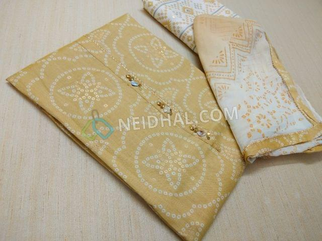 Premium Yellow Rayon Fabric(Flowy fabric, Requires lining) with Bandhini white and golden prints, with fancy buttons and tassels on placket, Printed Modal fabric, Block printed(since hand made, there might be overlaps and misprints these cannot be considered as damage)chiffon duaptta with taping