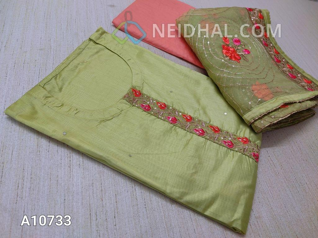 CODE A10733 :  Designer Light Green Soft Silk Cotton unstitched salwar material(requires lining) with Zari and thread, sequence work on yoke , neck stitch, daman patch, pink taffeta bottom, Heavy zari thread and sequence wrk on organza dupatta wih tapings