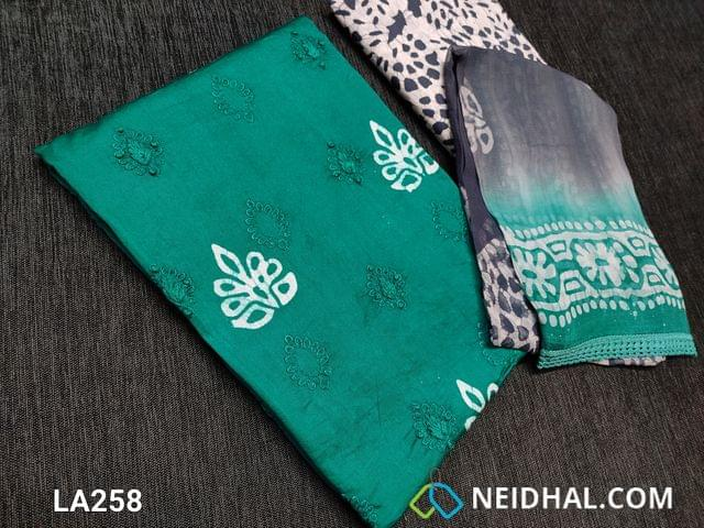 CODE LA258 : Designer Turquoise Green Satin Cotton unstitched salwar material with pure wax batik work and embroidery work on front side, Pure wax batik work on back side, Wax batik pure cotton bottom, Wax batik Pure chiffon dupatta with lace tapings