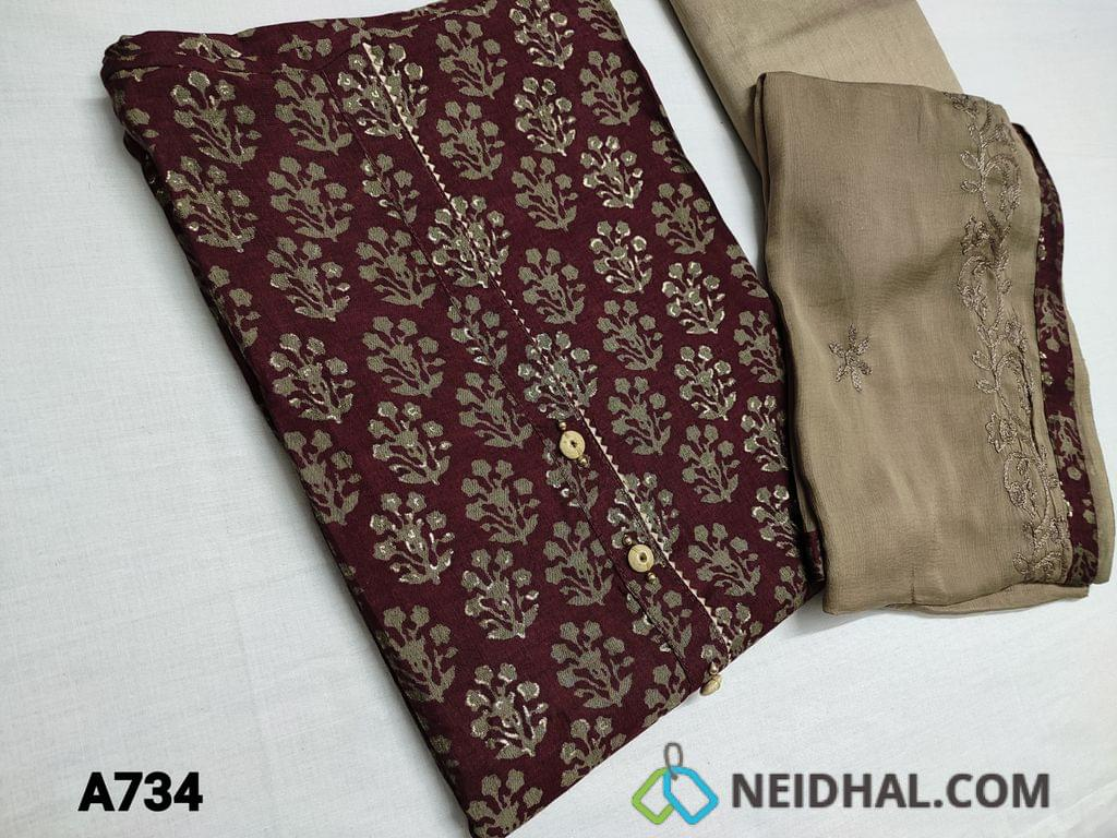 CODE A734: Purplish Maroon Visocus Silk Unstitched Salwar material( Soft, Silky and Flowy fabric requires lining) with Yoke patch with fancy buttons, Golden prints all over, daman patch, Dark beige silk cotton bottom, Chiffon dupatta with heavy embroidery work and tapings
