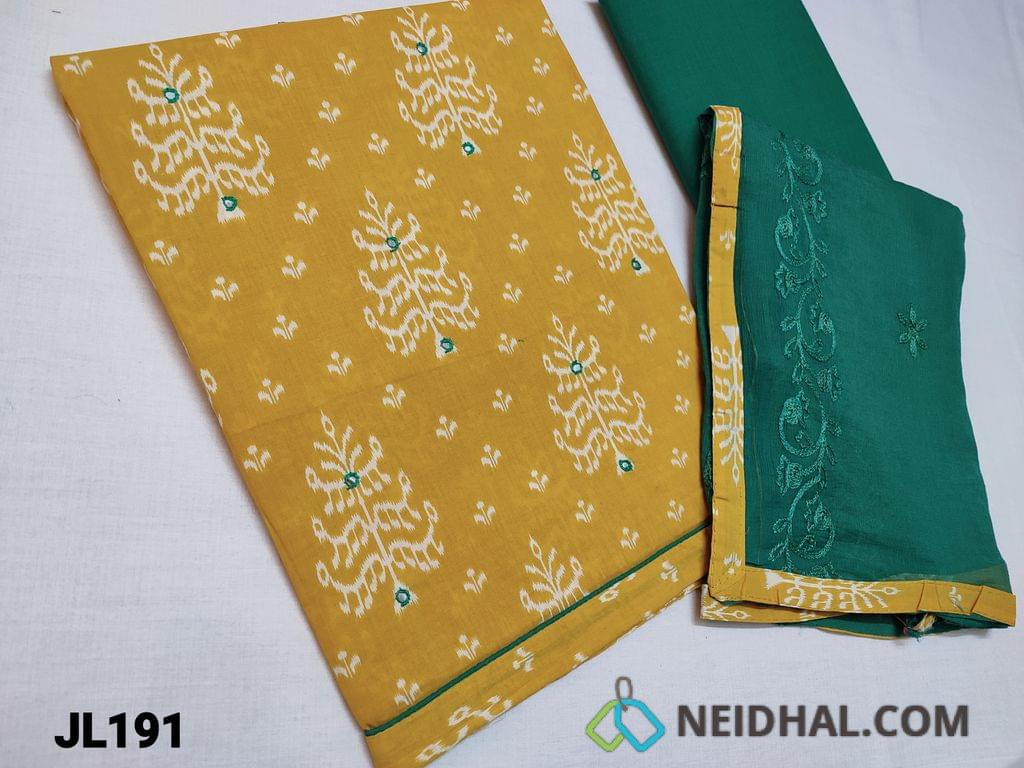 CODE JL191 :  Printed Fenu Greek Yellow cotton unstitched Salwar material with faux mirror work on front side, Daman piping, Green cotton bottom, Green Chiffon dupatta with embroidery work and taping