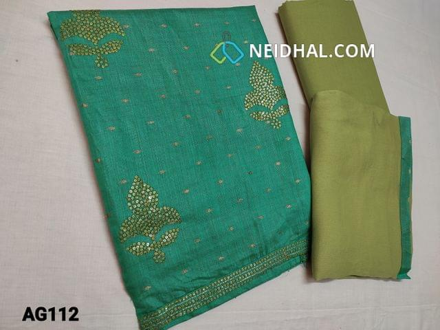 CODE AG112 : Light Turquoise Green Silk Cotton unstitched Salwar material(thin material requires lining) with Butta zari work on front side, sequins and thread work on yoke and daman, Plain back, Green cotton bottom, Green Chiffon dupatta with tapings