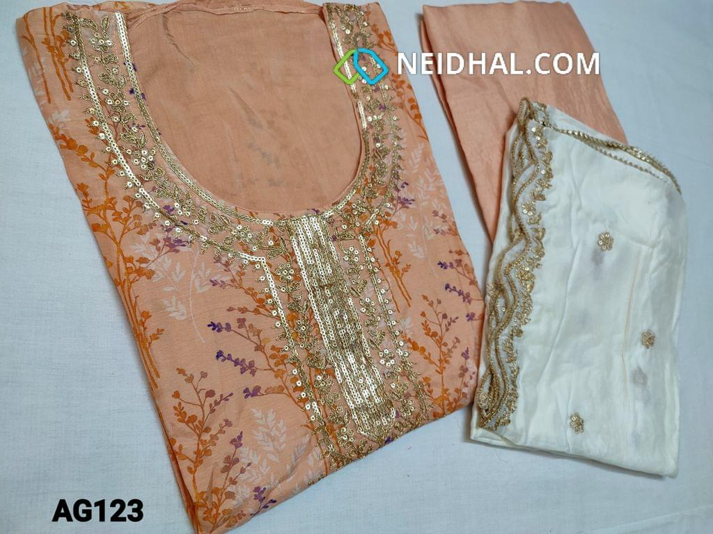 CODE AG123 : Peach Masleen unstitched Salwar material(thin shiny fabric requires lining) with beautiful floral prints, Heavy golden thread and sequins work on yoke, round neck, Plain back, Santoon bottom, Premium half white Silk cotton dupatta with all over sequins work and heavy work taping