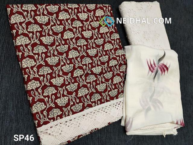CODE SP46 : Printed Maroonish Red Cotton unstitched Salwar material(requires lining) lace cut work at daman, embroidery cut work on half white kadhi cotton bottom, printed chiffon dupatta with lace tapings.