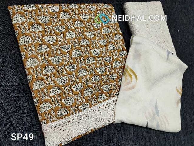 CODE SP49 : Printed Yellow Cotton unstitched Salwar material(requires lining) lace cut work at daman, embroidery cut work on half white kadhi cotton bottom, printed chiffon dupatta with lace tapings.