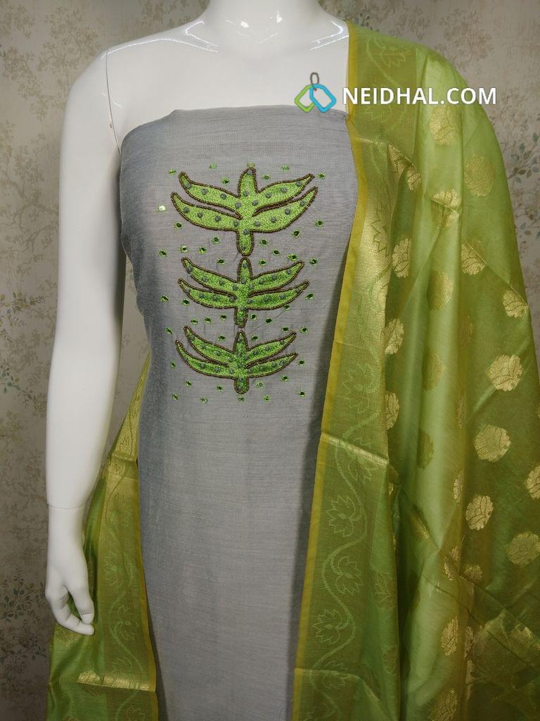Cement Grey Silk Cotton unstitched salwar material with foil mirror, french knot work on yoke, green silk cotton bottom, Benaras weaving silk cotton dupatta with tassels