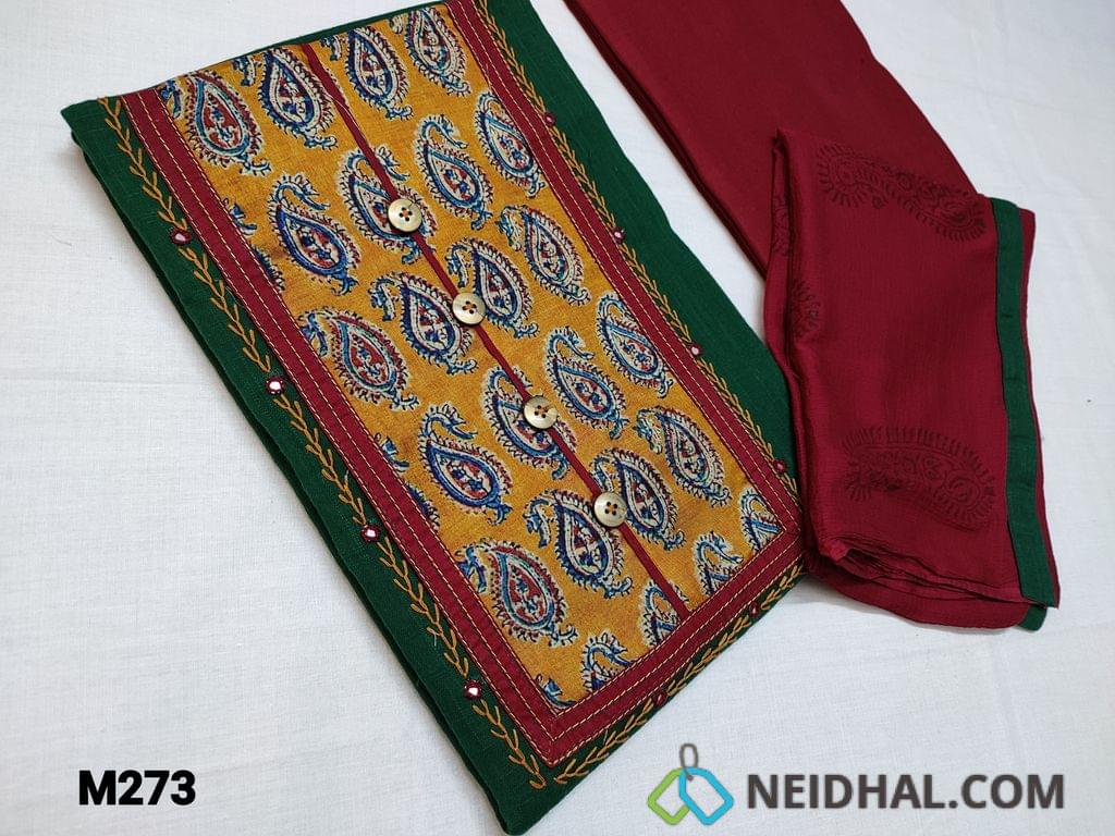 CODE M273 : Premium Dark Green Slub Cotton unstitched Salwar material with Paisley print silk patch work on yoke highlighted with feather stich and faux mirror work, Daman piping, Maroon Cotton bottom, Block printed Maroon chiffon dupatta with tapings