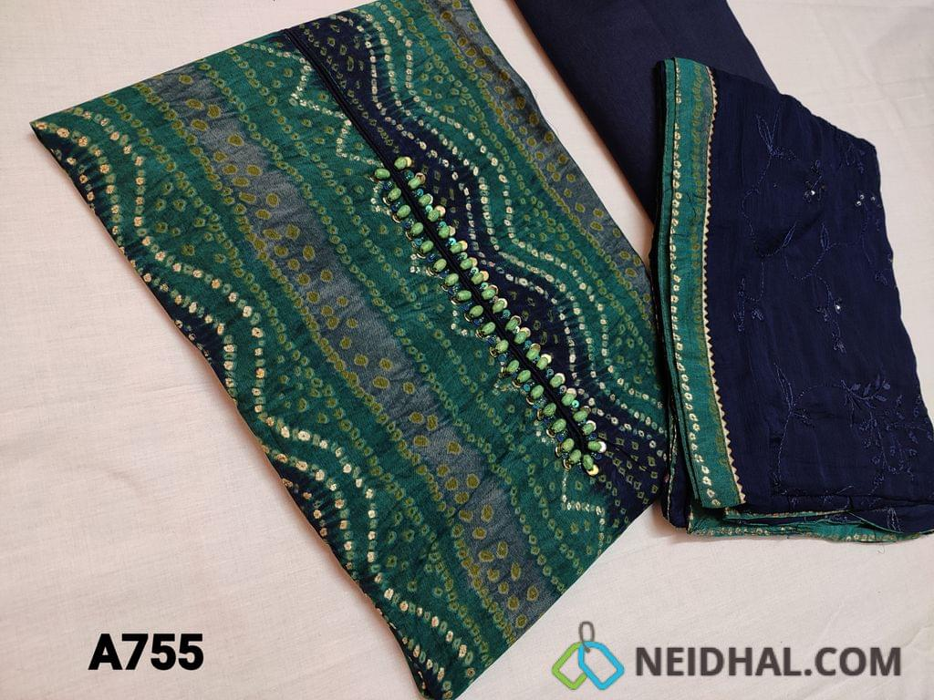 CODE A755 : Designer Printed Viscous Silk Cotton unstitched Salwar material(thin fabric requires lining) with Bandhini and golden prints, Wooden bead and sequins work on yoke, contrast piping on daman, Navy blue silk cotton bottom, Blue Chiffon dupatta with embroidery and sequins work with tapings