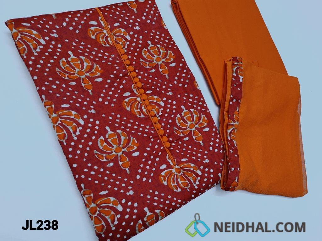 CODE JL238 : Printed Red Cotton unstitched Salwar material(lining optional) with potli button on yoke, daman patch, Orange cotton bottom, Plain Orange chiffon dupatta with taping