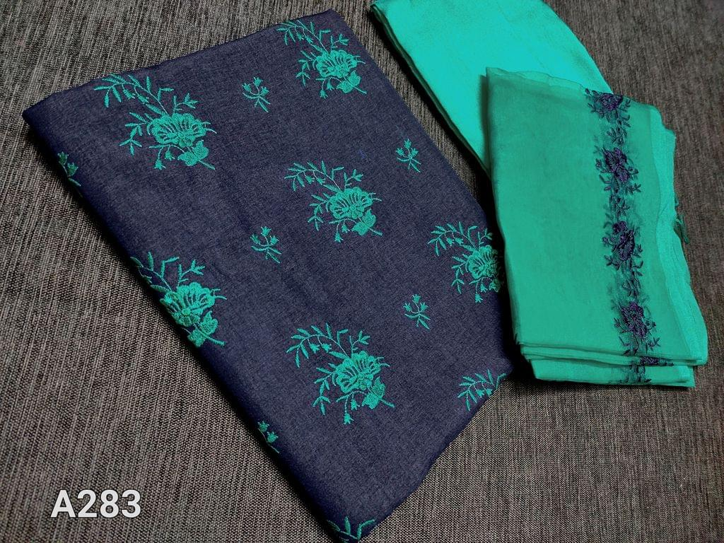 CODE A283 : Blue silk cotton unstitched Salwar material(coarse fabric requires lining) with Thread embroidery work on yoke, Turquoise Green silk cotton bottom, Turquoise Green Organza dupatta with embroidery patterns and tassels.