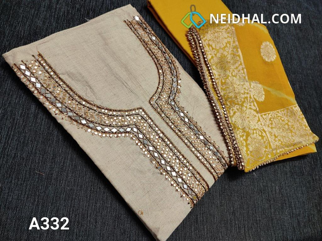 CODE A332: Designer Beige Tissue Silk Cotton Unstitched Salwar material(requires lining) with Real mirror sequence and zardosi work on yoke, Faux mirror work on front side, plain back, Yellow cotton bottom, Shibori zari weaving pure Georgette short width dupatta with lace taping