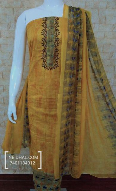 Printed Yellow Cotton unstitched salwar material with thread work, emboridery work on yoke, daman patch, prined cotton bottom, printed nazneen dupatta with taping.
