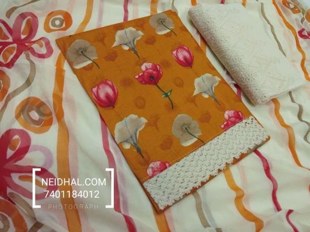 Floral Printed Orangeish Yellow Satin Cotton unstitched salwar material, lace daman patch, half white chigan work kadhi bottom, printed chiffon dupatta.( tapping required)