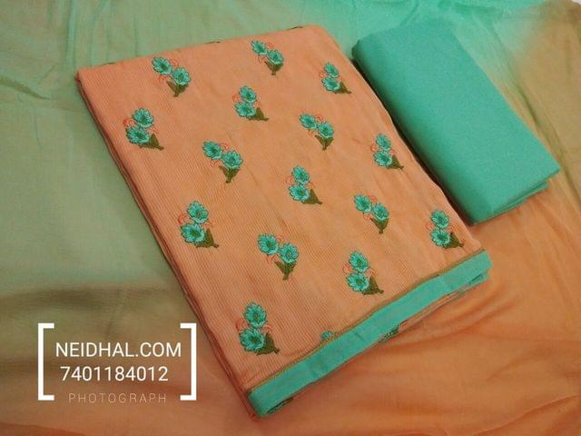 Orange Silk Cotton unstitched salwar material with embroidery work on front side, daman patch, green cotton bottom, Dual color chiffon dupatta with tappings.