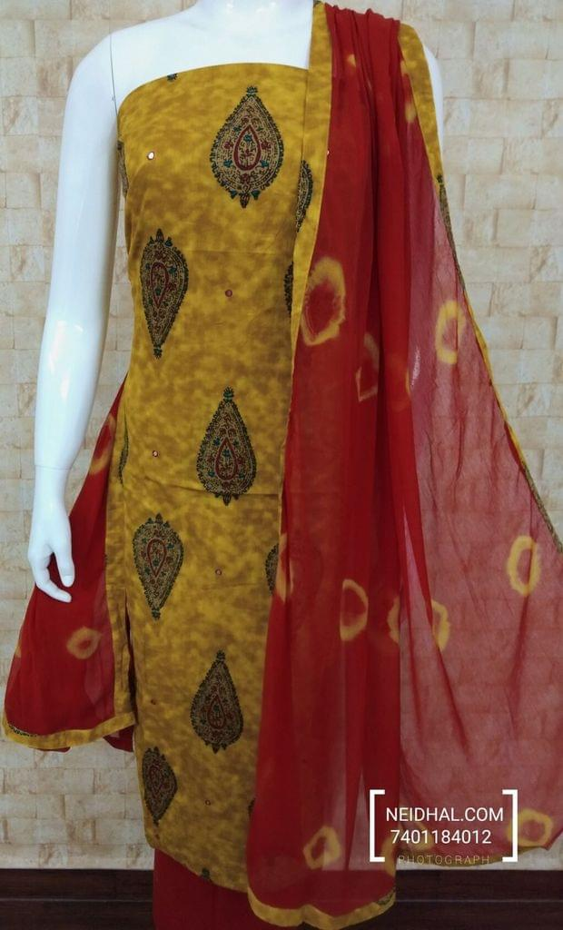 Printed Yellow Cotton Unstitched salwar material with thread and foil mirror work, red cotton bottom, printed  chiffon dupatta with tappings.