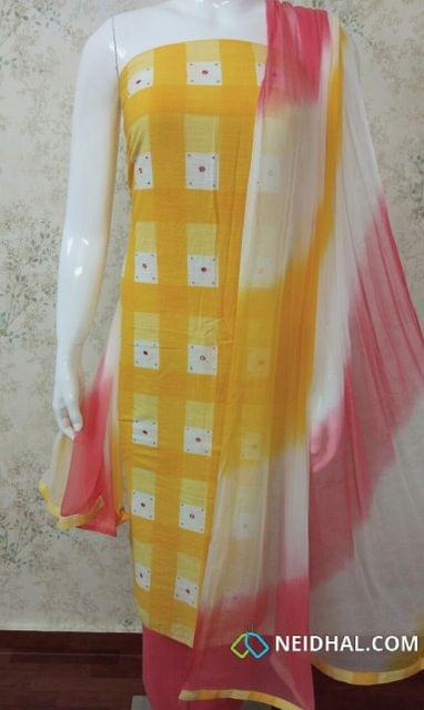 Checked Yellow Cotton Unstitched salwar material With foil mirror work, mini stone work, pink cotton bottom,multi color chiffon dupatta with tapings.