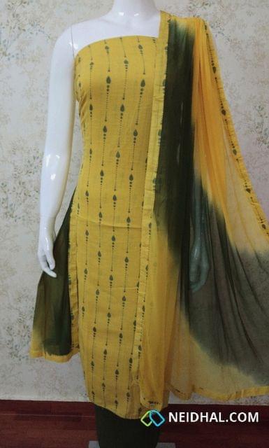 Printed Yellow Slub Cotton Unstitched salwar material , green cotton bottom, green chiffon dupatta with tapings.