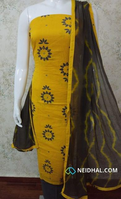 Printed Yellow Cotton Unstitched salwar material with french knot and foil mirror work,  dark grey cotton bottom, Printed dark grey chiffon dupatta with tapings.
