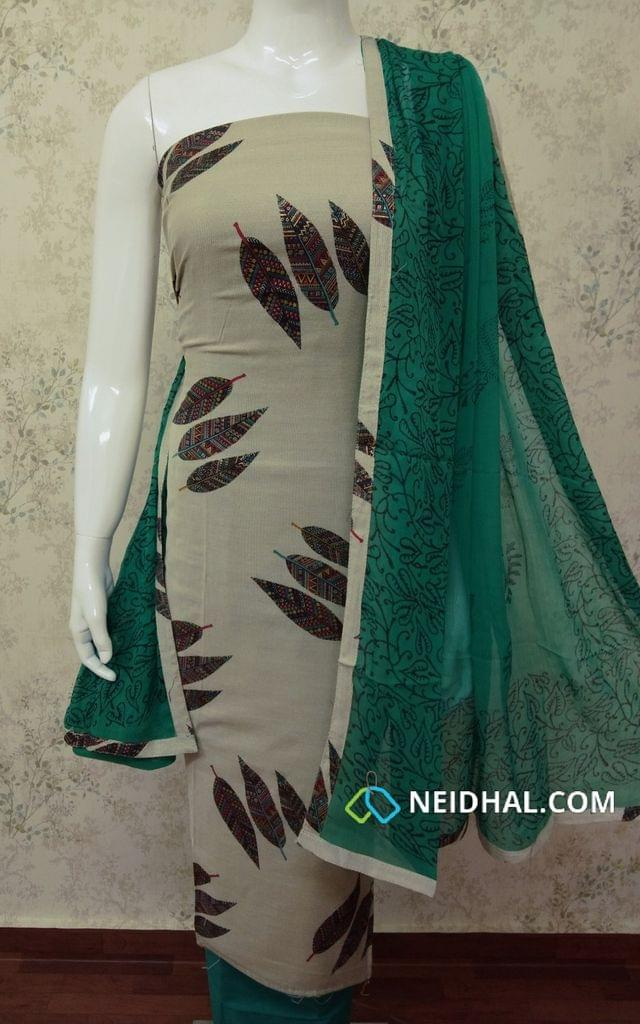 Beige Soft Spun Cotton Unstitched salwar material with Golden Leaf Prints, green cotton bottom, printed green chiffon dupatta with tappings.