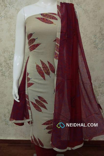 Beige Soft Spun Cotton Unstitched salwar material with Golden Leaf Prints, maroon cotton bottom, printed maroon chiffon dupatta with tappings.