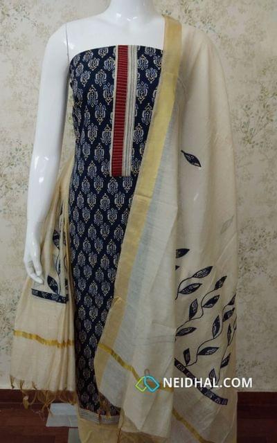 Printed Navy Blue Slub Cotton Unstitched salwar material with yoke patch, dark cream cotton bottom, patch work on silk cotton dupatta with tassels.