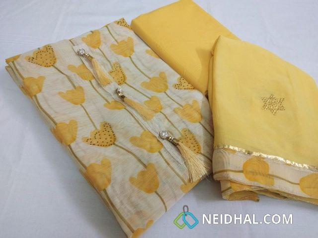Designer Cream Chanderi Unstitched salwar material(requires lining) with digital prints with mini stone works, fancy button tassels, Yellow Cotton bottom, golden dew drop work on chiffon dupatta with taping.