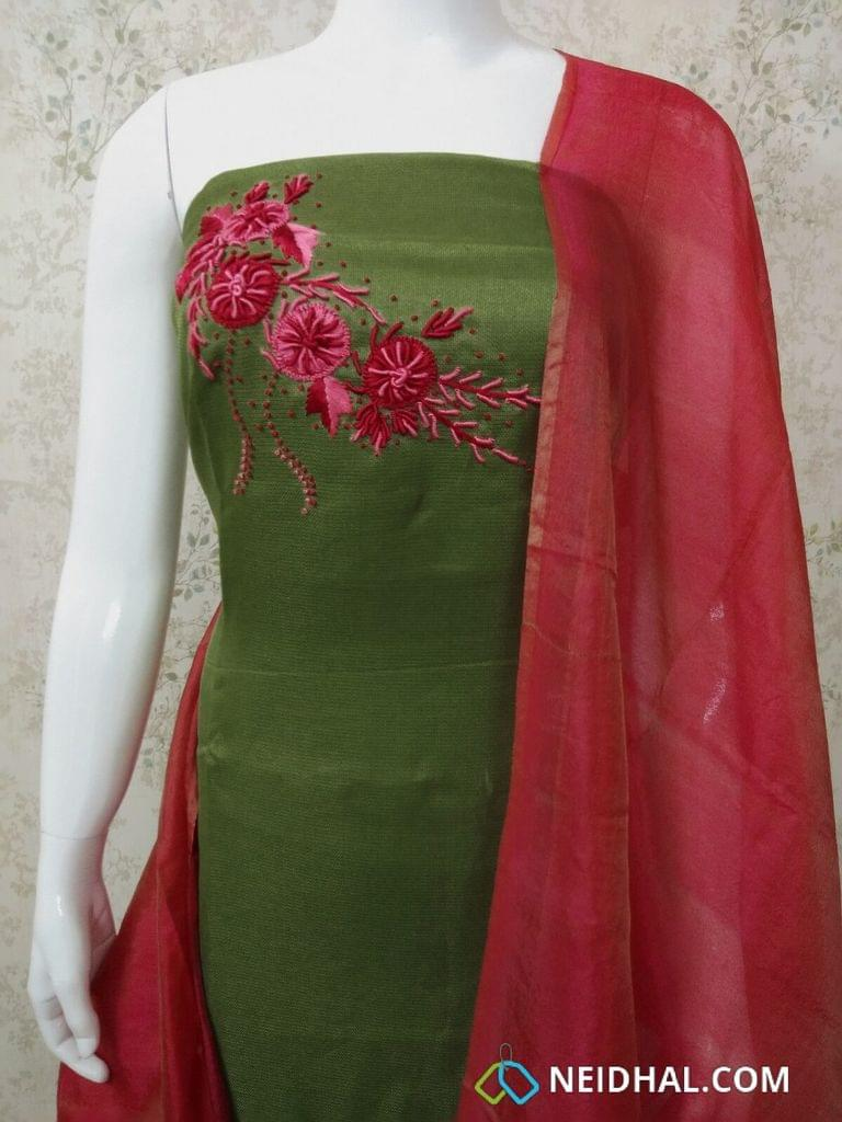 Designer Green Accord(Super Net) Fabric unstitched salwar material(requires lining) with heavy thread and french knot work on yoke, dark pink silk cotton bottom, pink fancy silk  dupatta wit tassles.